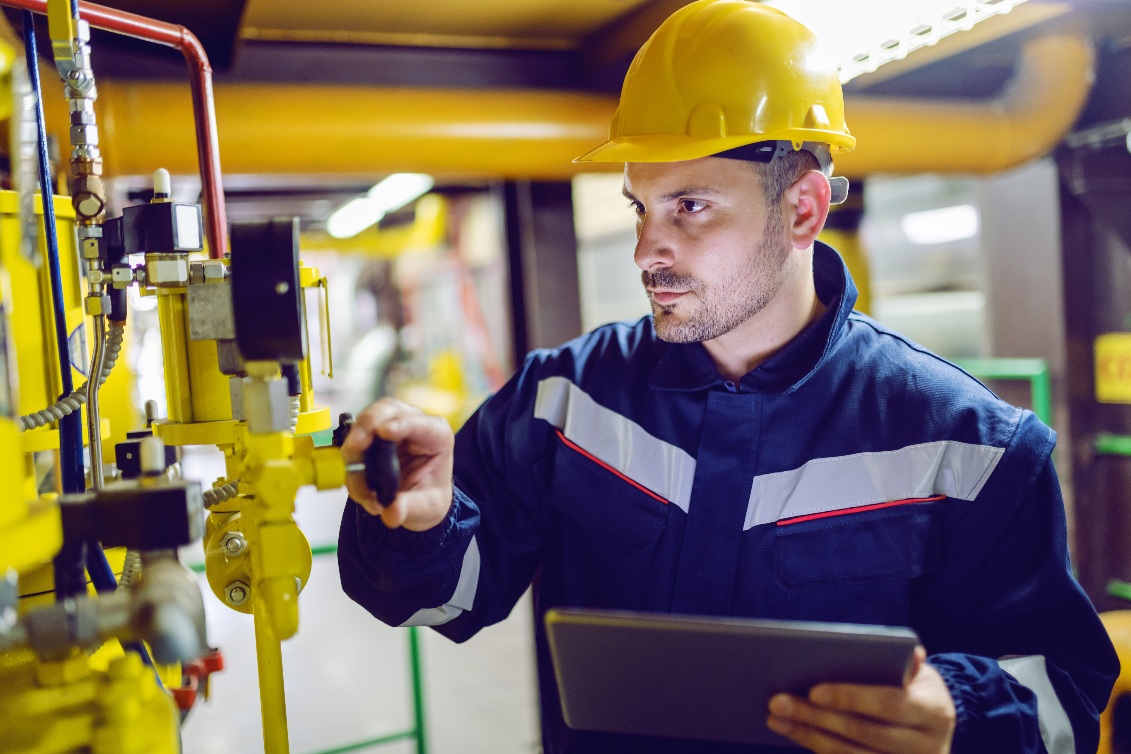 plant worker in energy industry using EHS software